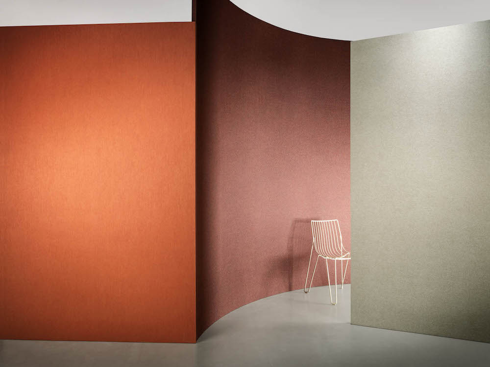 simple orange and red wall covering with chair