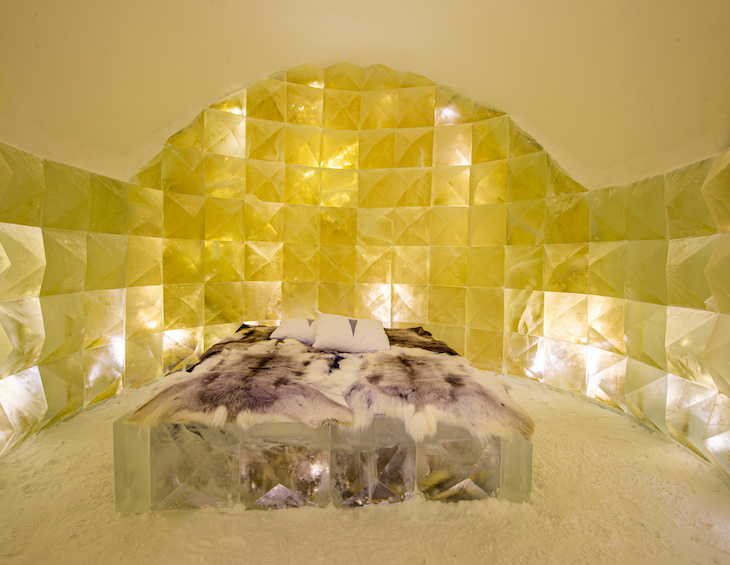 gold hue in room full of ice and a bed