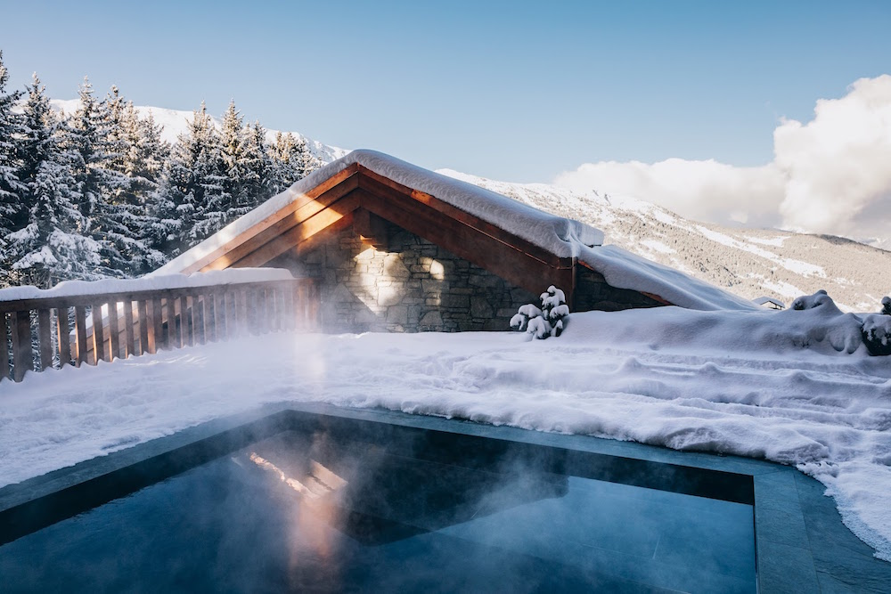 Pool overlooking snowy slopes