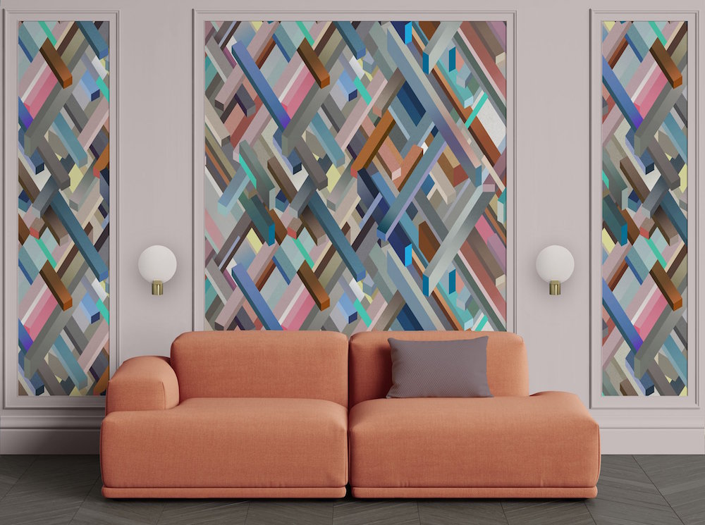 Colourful textures on the wall in front of a soft coral low-level sofa