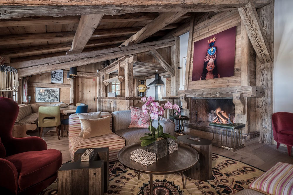 Traditional chalet looking interiors with deep red furniture and wooden ceilings