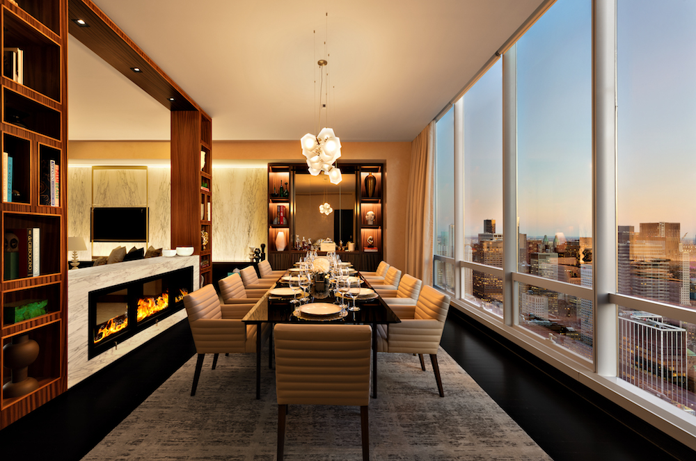 Luxury dining area with views of new york on the right