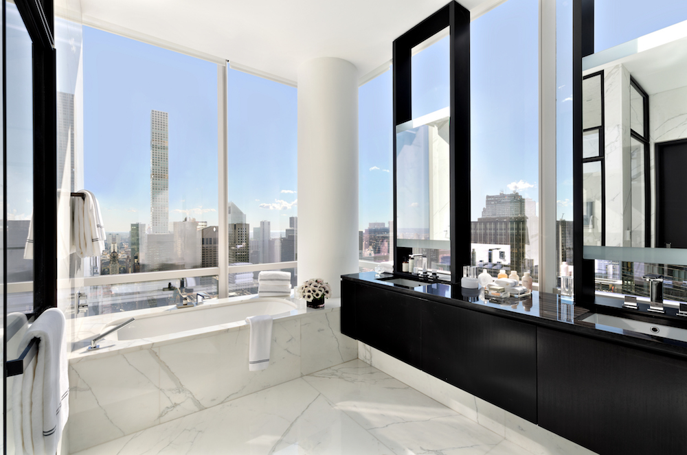 White marble bathroom with views of New York City