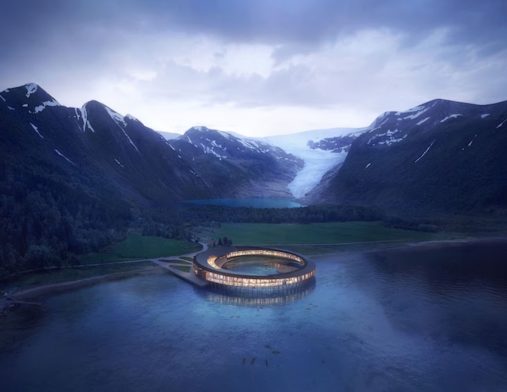 render of hotel in the middle of water next to snow-capped mountains