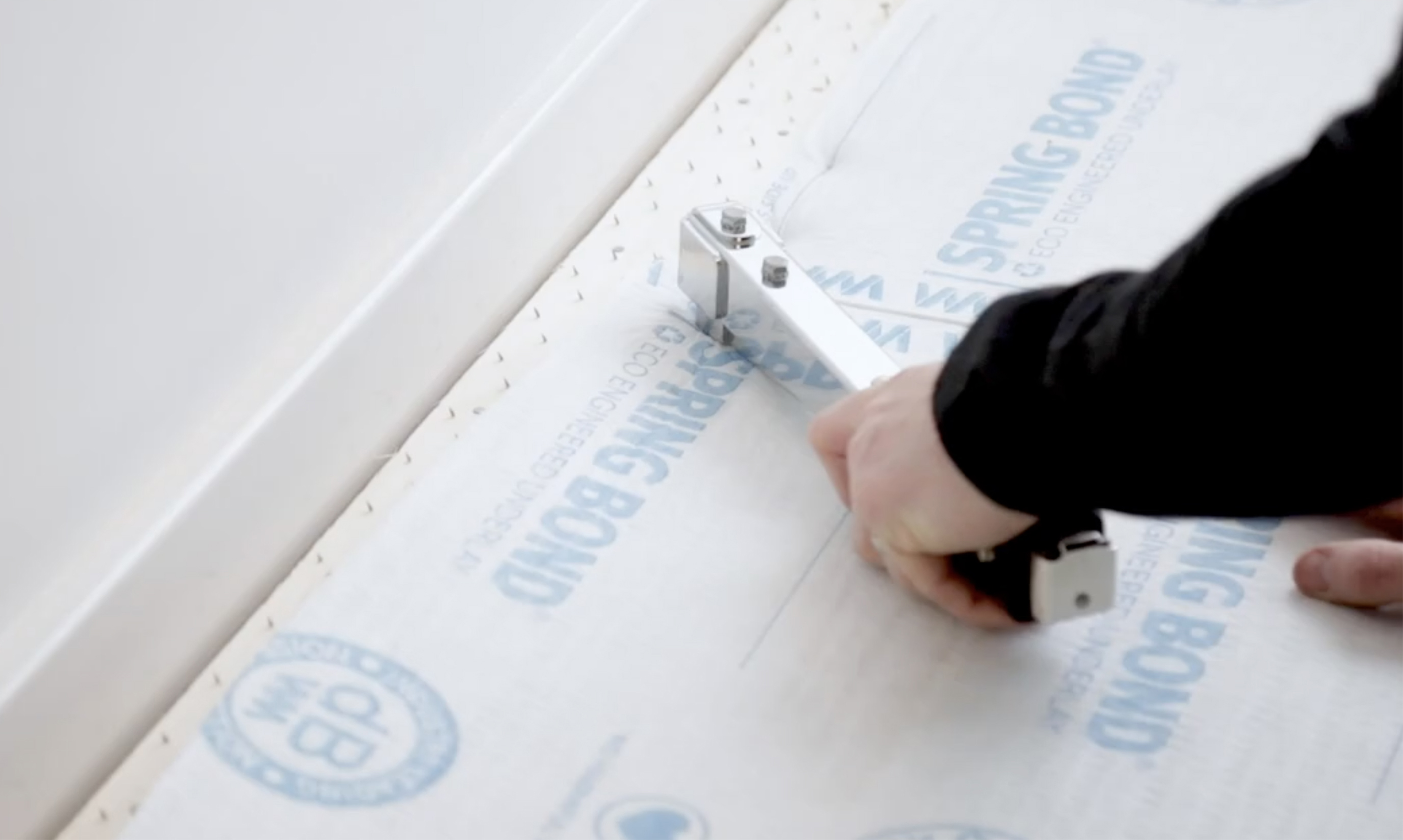 Close up of man fitting the carpet underlay
