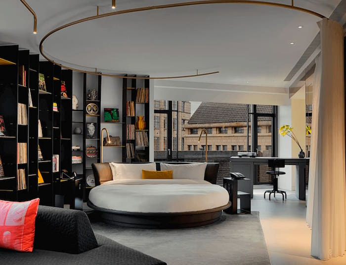 luxe bedroom in W Amsterdam with round bed and gold fittings