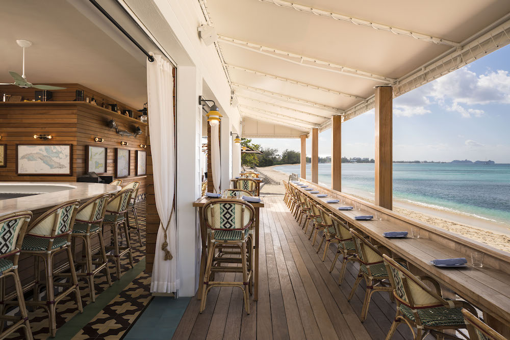 bar designed in natural wood overlooking the sea