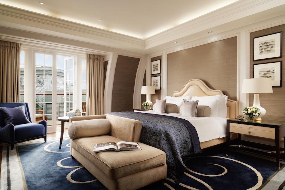 large bedroom with luxe bed with theme of blue