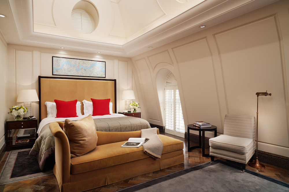 Large bedroom with brown headboard and red cushions