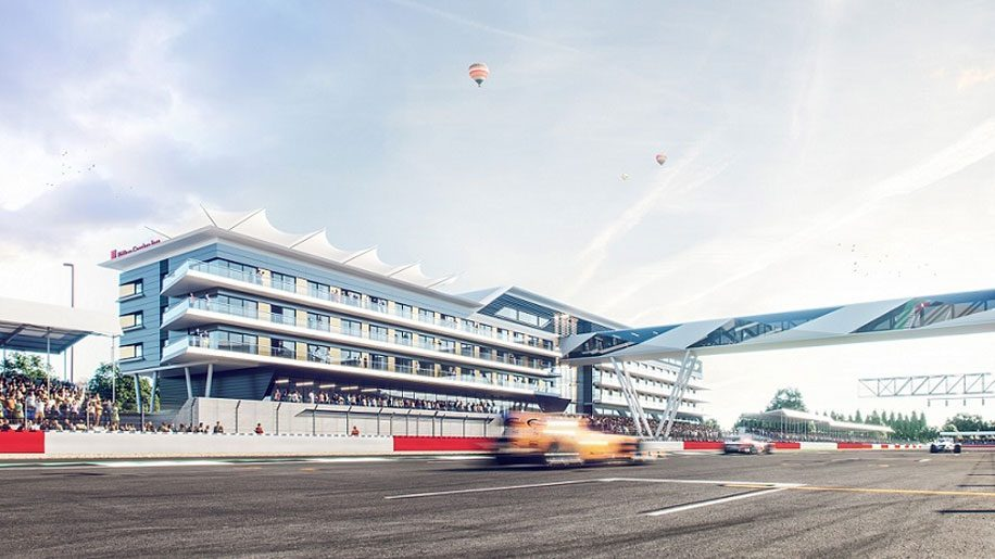 Render of modern building overlooking racetrack