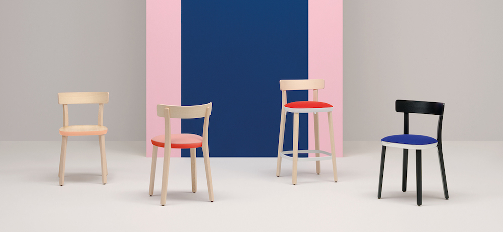 Studio image of four varying sized chairs with blue and pink background