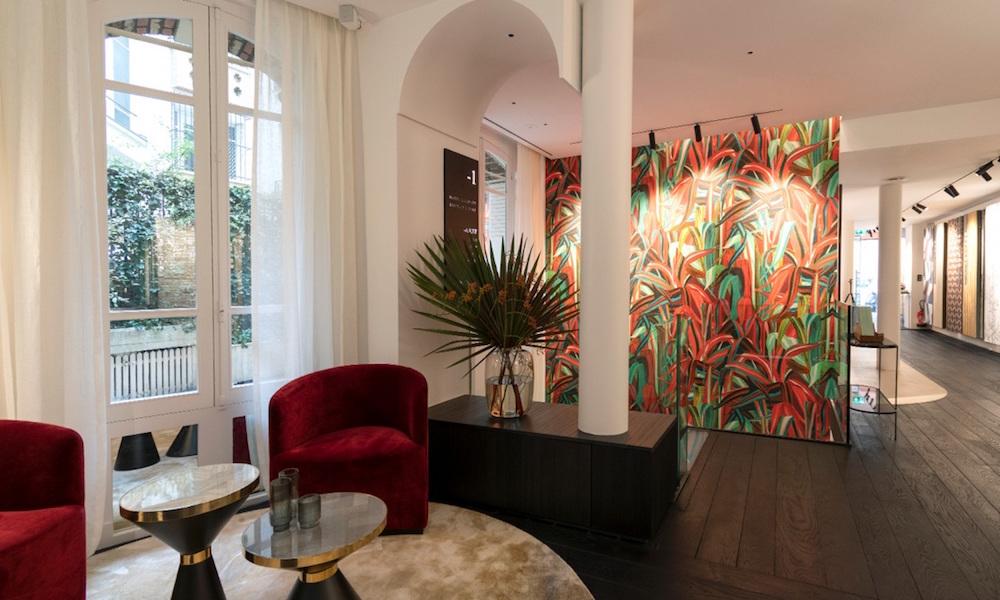 Showroom with large colourful, jungle-like wall