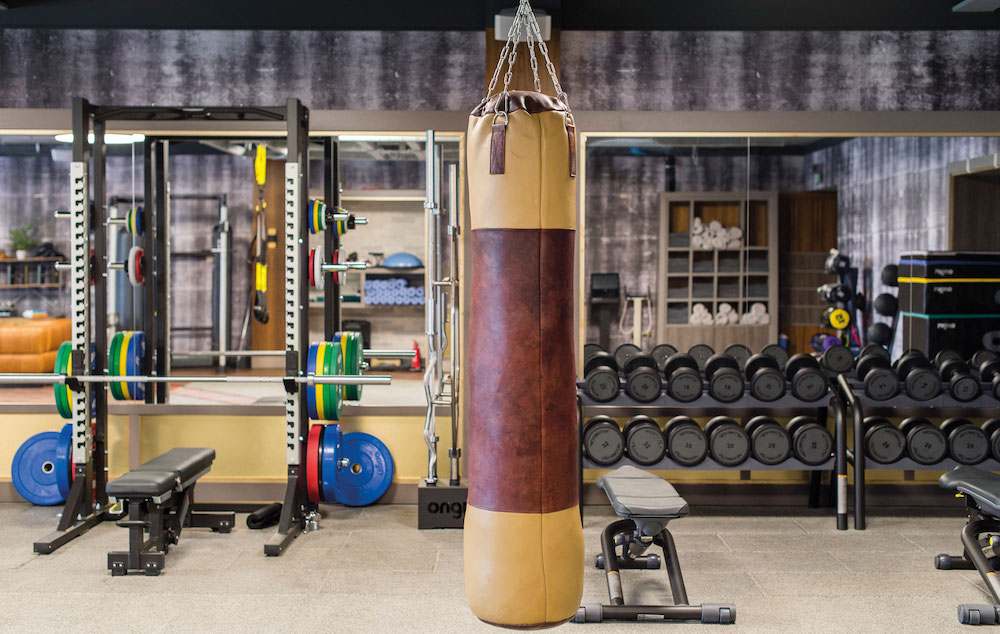 New-York style gym area with punch bag and weights area