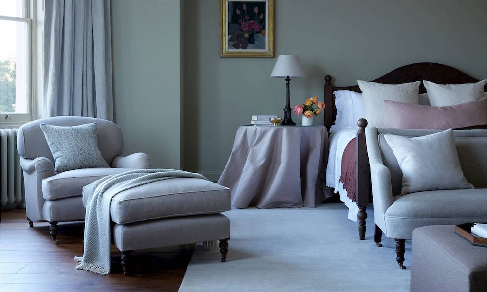 Soft pastel colours on bed and on armchair