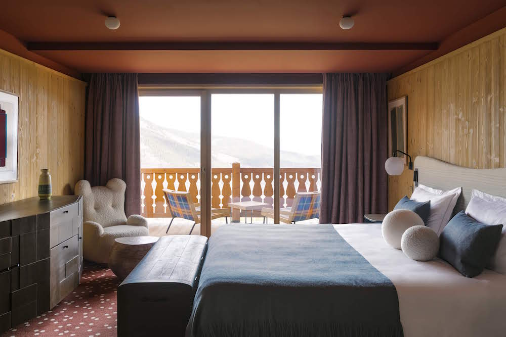 Bed and balcony door overlooking the piste