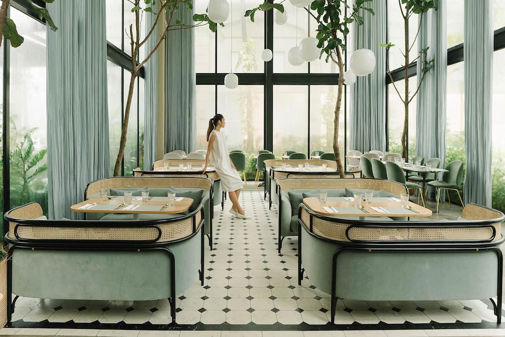 Woman in the middle of biophilic restaurant