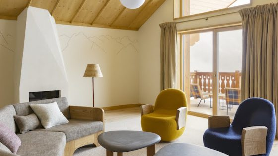 Yello and blue contemporary arm chairs in light chalet-style room