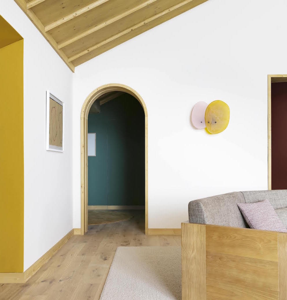 White walls with yellow lighting and door frames