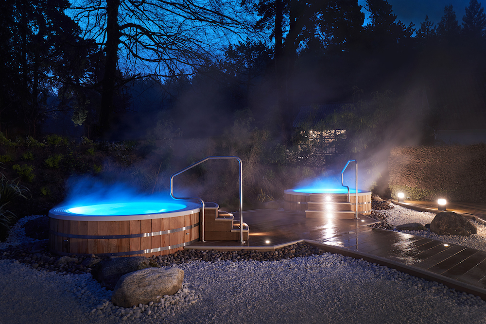 outdoor hot tubs with steam coming off them