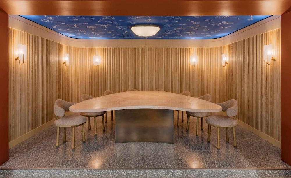 blue ceiling with odd shaped table under