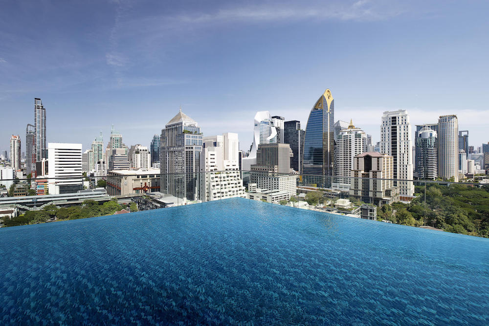 Image of pool and skyline of Bangkok