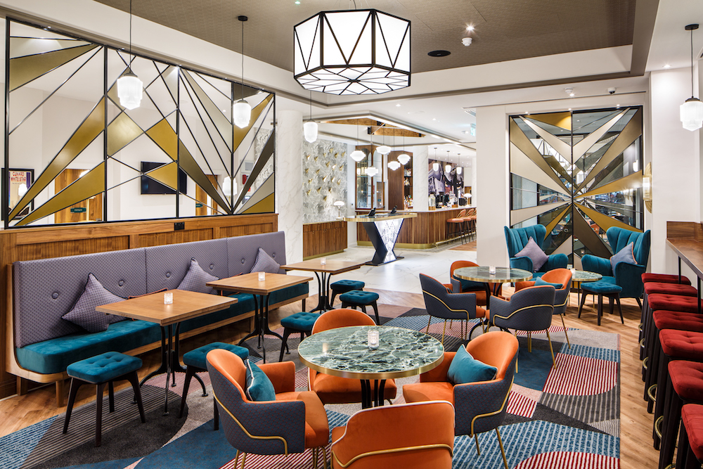 Quirky Art Deco carpets, mirrors and furniture in lobby