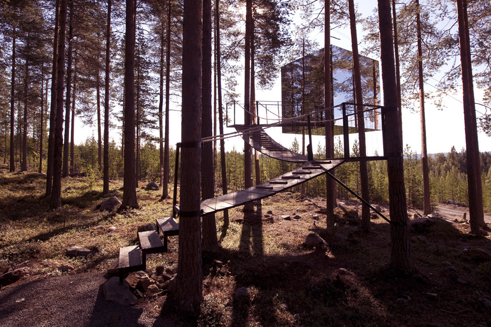 Glass-mirrored structure hanging from trees