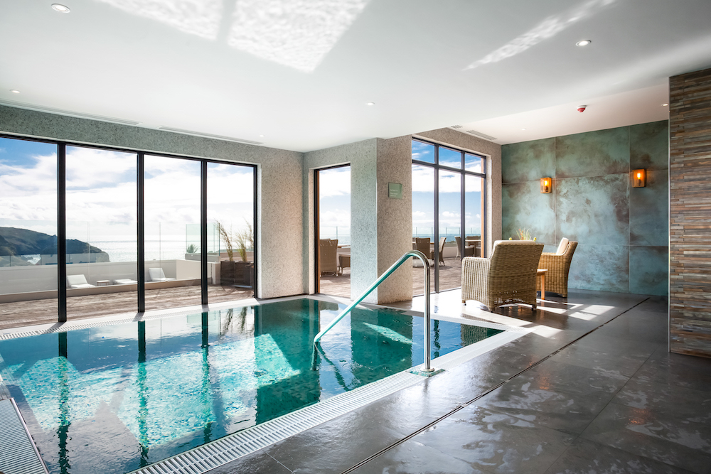 Indoor pool with glass overlooking bay