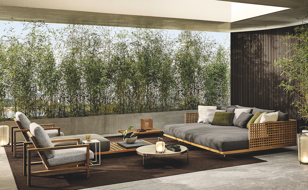Living wall behind the outdoor furniture collection
