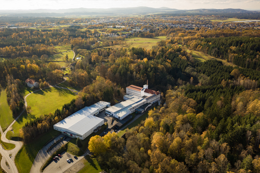 The factory, which is located in between rolling mountains and hills in Austria