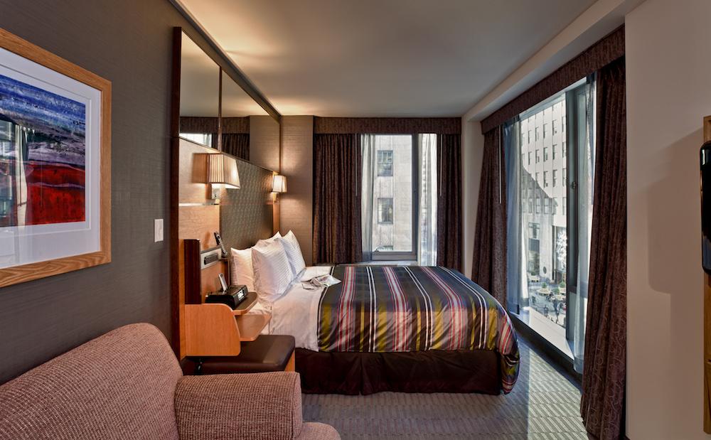 Image caption: Guestroom inside The Jewel Hotel New York