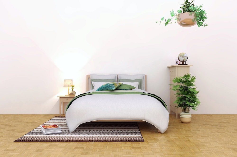 Whit room with white bed and plants