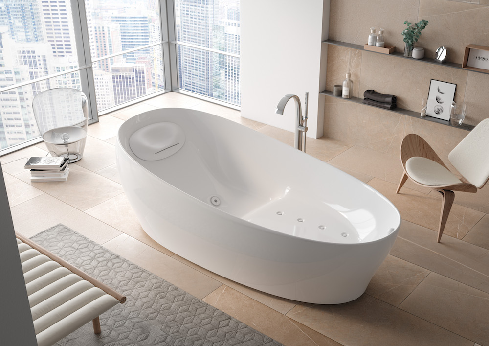 A large bath with massage jets in a modern bathroom
