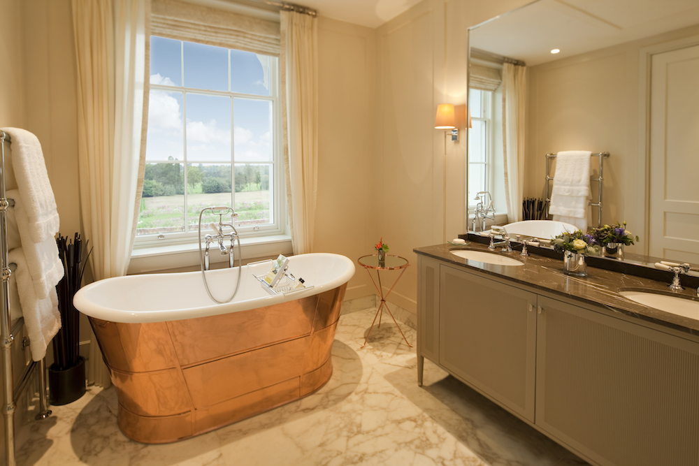 Image caption: The bathroom inside a Junior Suite at Coworth Park in Ascot, which is part of Dorchester Collection