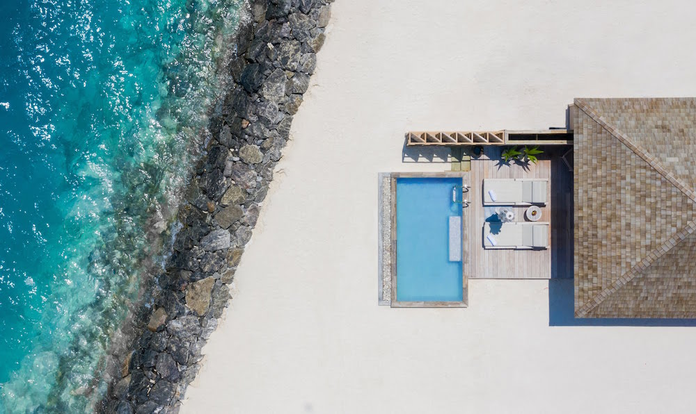 Birds eye view of villa with pool by the ocean