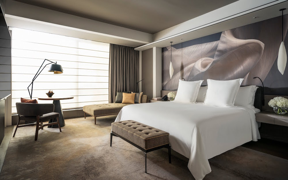 Luxury bed with striking flowing headboard
