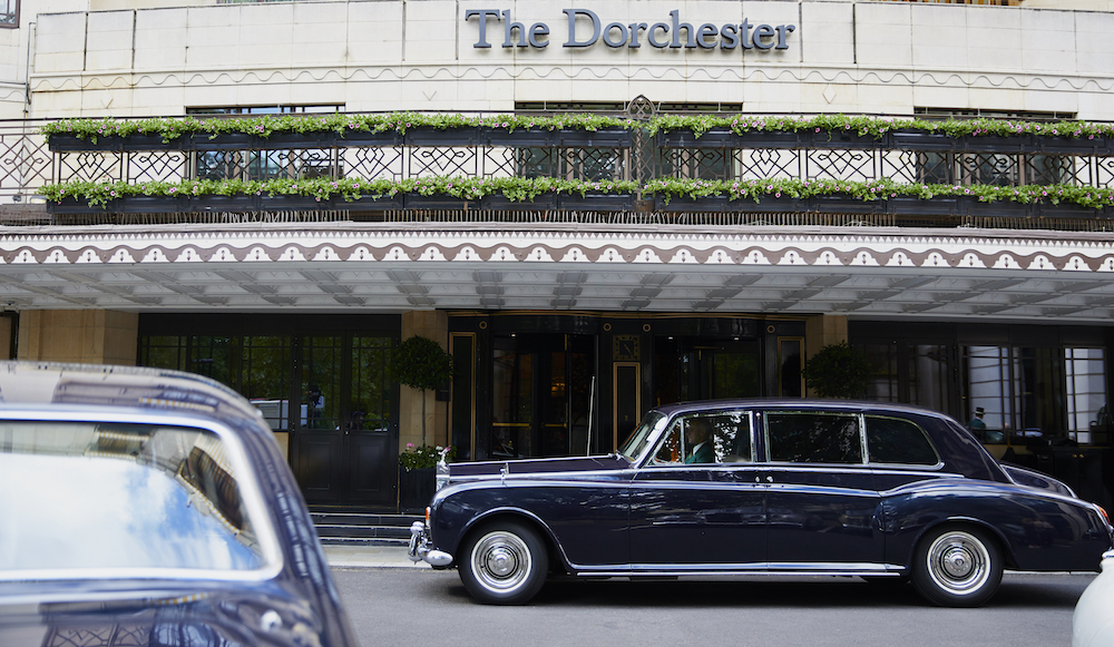 Image caption: Arriving in style, a blue Rolls Royce Phantom rolling up to The Dorchester's main entrance