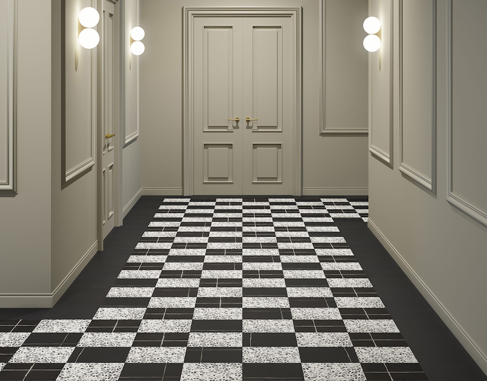 A hotel room door with monochrome tiles on the corridor floor