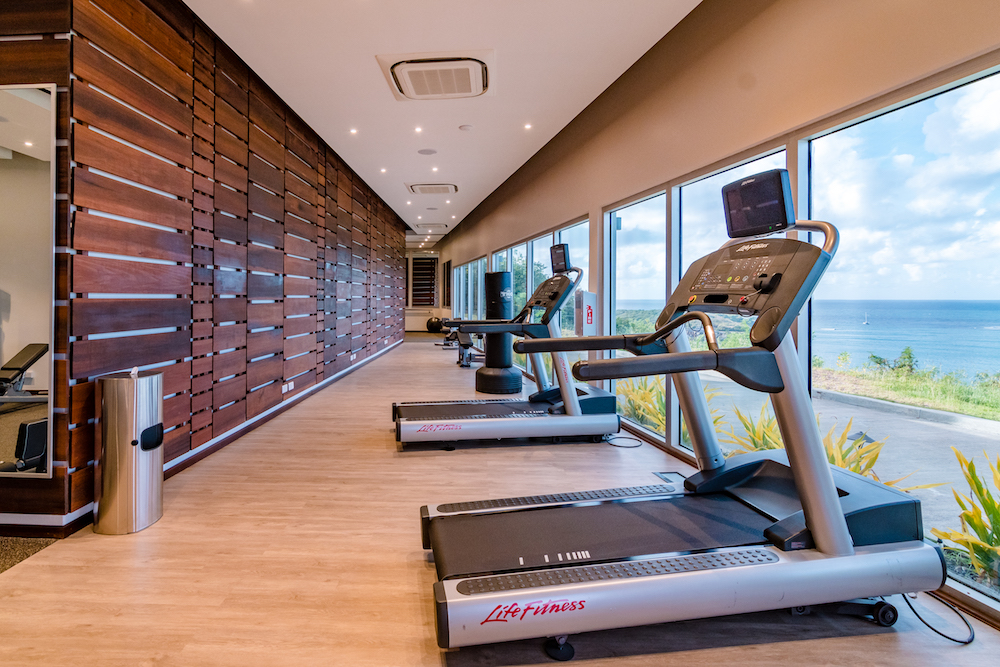 Image caption: The gym at the resort overlooking the bay. | Image credit: The Point.