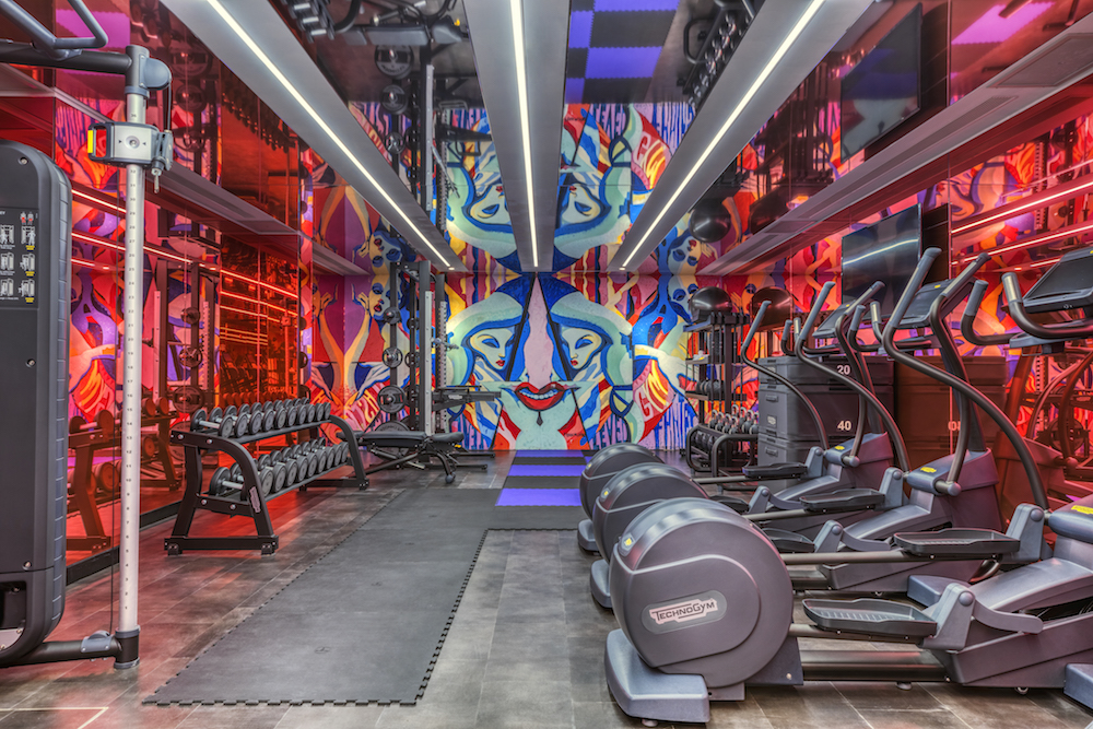 A red neon mix of colours inside the gym area