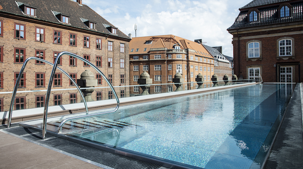 a rooftop pool overlooking Copenhagen