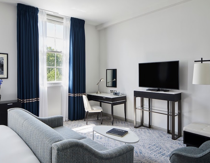 Minimalist luxury guestroom inside the Marriott hotel on Grosvenor Square