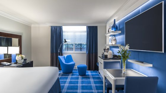 Sofitel London St James luxury room with blue tartan carpets and blue modern furniture