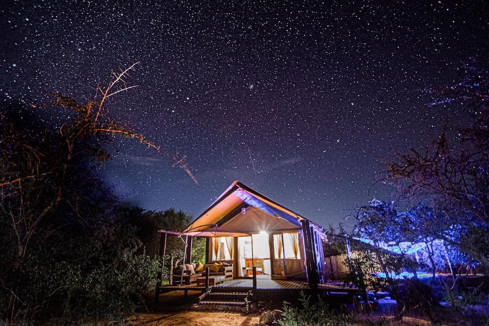 A tented accommodation in the middle of nowhere with stars above