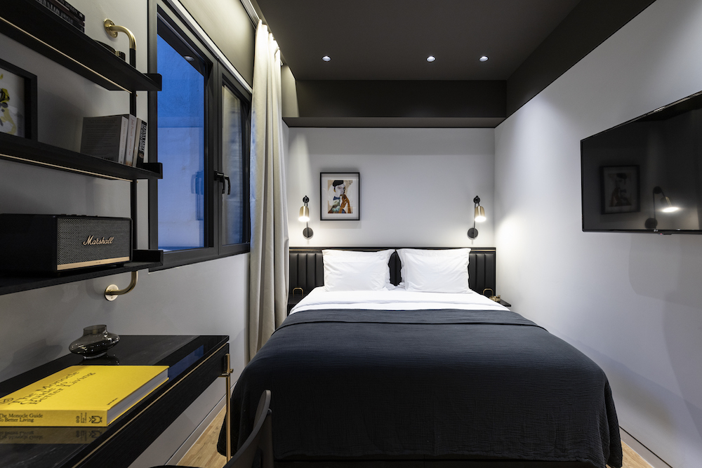 Image of a guestroom with contemporary interiors inside The Modernist in Athens