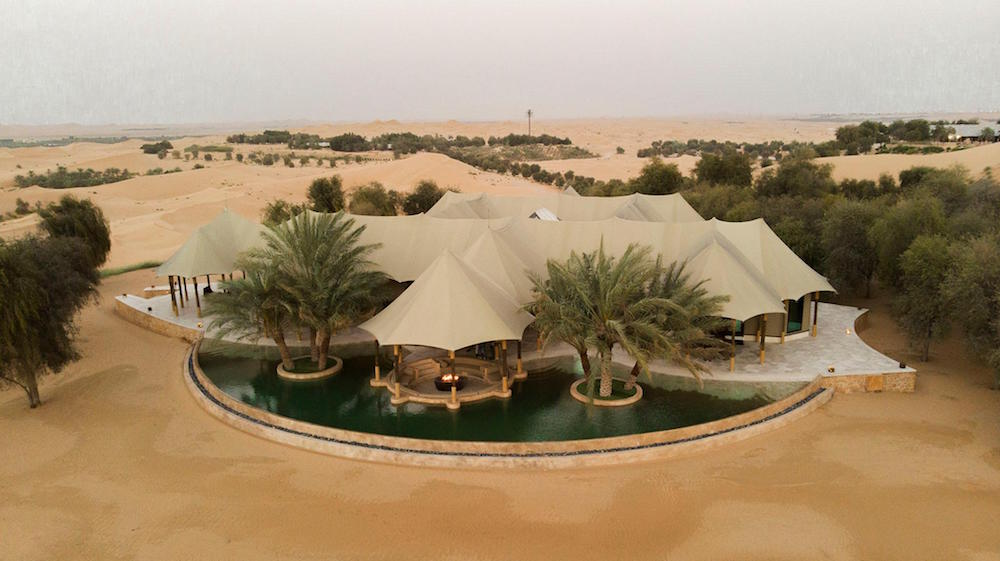 Aerial view of tented accommodation in the desert