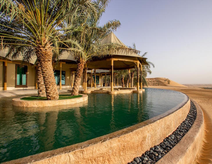 A luxury pool and tented accommodation in the middle of the desert