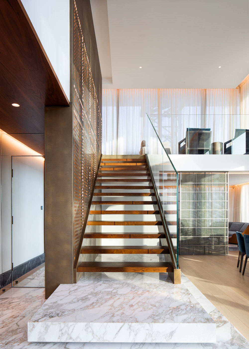 A stairway up to more living area in suite