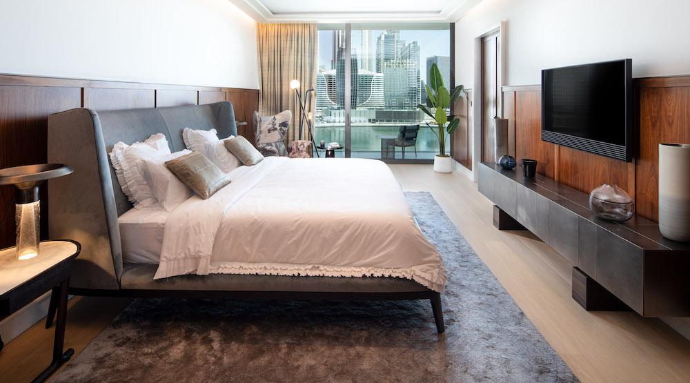 A large masculine bedroom overlooking Dubai