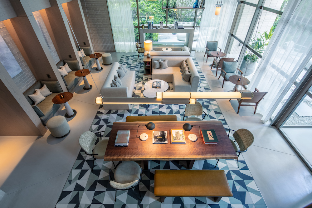 A birds eye view of a contemporary lounge with dining area and sofas on geometric flooring